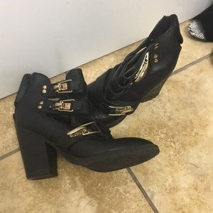 Heeled cutout booties size 7